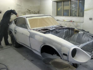 240Z bodywork being masked ready for spraying